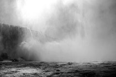 The Drama of Niagara Falls. This black and white river view captures the powerful drama of Niagara's thunderous Horseshoe Falls Royalty Free Stock Images