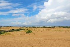 Dramatc clouds and sand dunes viewed from Jockeys Ridge State Pa Stock Image