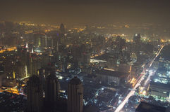 Dramatic aerial view of Bangkok, Thailand. Dramatic aerial view of Bangkok city at night from the Baiyoke Sky Hotel the tallest hotel in Southeast Asia and the Stock Photography