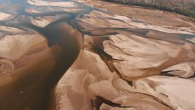 Dramatic aerial view of empty Vistula riverbed in Poland. Very dry summer. Drought natural disaster.