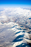 Dramatic Aerial view of snow-covered mountains Stock Photos