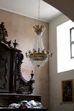 Dramatic ancient interiors with chandelier Royalty Free Stock Photos