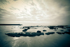 Dramatic Atlantic coast at low tide. Tinted Stock Images