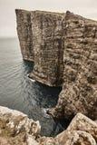 Dramatic atlantic rocky coastline cliffs landscape in Vagar. Faroe