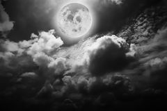 Dramatic atmosphere panorama of full moon and clouds. Stock Image
