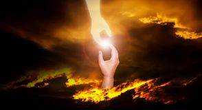 Dramatic atmosphere panorama scene of God`s helping hand reach t. O human saving them from trouble Stock Image