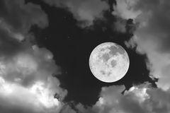 Dramatic atmosphere panorama view of beautiful full moon and clo royalty free stock image