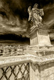 Dramatic atmosphere with statue of Angel from Angel`s Bridge Stock Photography