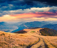 Dramatic autumn panorama in the mountain village Stock Images