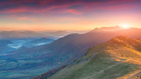 Dramatic autumn sunset in the mountain Stock Photography