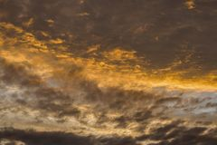 Dramatic background of fiery sunset at cloudy sky.  royalty free stock photo