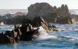 Waves crashing on rocky coastline near Monterey, California, USA. Dramatic background of ocean waves on Asilomar State Marine Reserve, Pacific Grove near Stock Photography