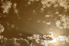 Dramatic background. Toned cloudy sky with white gray clouds. Toned cloudy sky with white gray clouds stock images