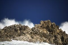 Dramatic big stormy crashing waves splash. Kleinmond, Western Cape, South Africa. stock photos