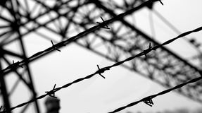 Dramatic black and white barbed wire fence Stock Images