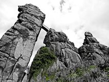 Dramatic black and white Externsteine rocks Stock Images