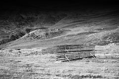Dramatic black and white fence in mountains royalty free stock images