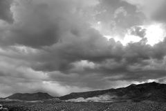 Dramatic black and white photo of huge monsoon clouds over the Santa Catalina mountains in Tucson Arizona. Huge clouds over the mountains in Tucson. Gigantic Royalty Free Stock Image