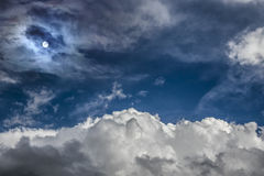 Dramatic blue clouds and moon Stock Images