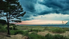 Dramatic blue clouds over sea coast Royalty Free Stock Photos
