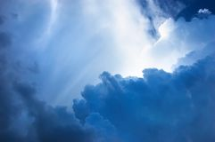 Dramatic blue cloudscape. Dramatic deep blue cloudscape, brightly lit in several places Stock Photo