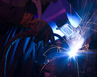 Dramatic blue-lit MIG welding close Royalty Free Stock Images