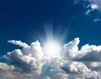 Dramatic blue sky with clouds and sun rays. Dramatic blue sky with white clouds and sun rays Stock Image