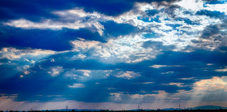 Dramatic blue sky with clouds and sun rays Royalty Free Stock Photos