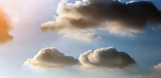Dramatic blue sky with fluffy clouds and sun shine Royalty Free Stock Images