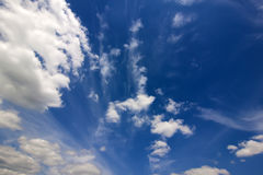 Dramatic blue sky with puffy white clouds in bright clear spring Royalty Free Stock Photo