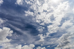Dramatic blue sky with puffy white clouds in bright clear spring. Day Royalty Free Stock Photo
