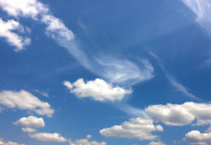 Dramatic blue sky with puffy white clouds in bright clear sunny. Day Stock Photography