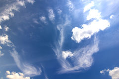 Dramatic blue sky with puffy white clouds in bright clear sunny. Day Royalty Free Stock Image