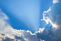 Dramatic blue sky and sunbeams Stock Photos