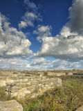Dramatic blue sky with white clouds over the ruins of the ancient greek colony of Histria, on the shores of Black Sea. Histria is Royalty Free Stock Photos