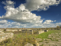 Dramatic blue sky with white clouds over the ruins of the ancient greek colony of Histria, on the shores of Black Sea. Histria is Stock Photo