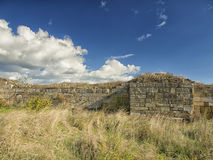 Dramatic blue sky with white clouds over the ruins of the ancient greek colony of Histria, on the shores of Black Sea. Histria is Stock Photography