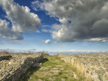 Dramatic blue sky with white clouds over the ruins of the ancient greek colony of Histria, on the shores of Black Sea. Histria is Royalty Free Stock Image