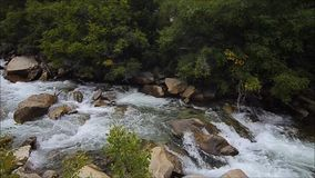 Dramatic boulders and ragging creek. Colorful Colorado Chalk creek in fall ragging down the Rocky Mountains stock video footage