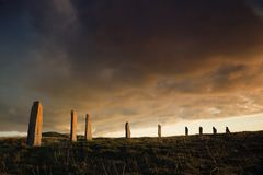 Dramatic brodgar. Ring of Brodgar in dramatic evening light and cloudscape royalty free stock images