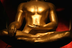 Dramatic Buddha's torso. Dramatic golden Buddha's torso royalty free stock images