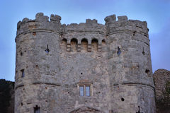 Dramatic Castle Tower. Dramatic looking entrance gate, tower and stone wall at Carisbrooke Castle on the Isle of Wight Royalty Free Stock Images