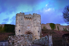 Dramatic Castle Wall and Tower. Dramatic looking entrance gate, tower and stone wall at Carisbrooke Castle on the Isle of Wight Royalty Free Stock Photos