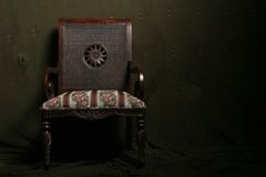 Dramatic chair. Vintage chair with dramatic lighting stock images