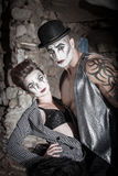 Dramatic Cirque Couple. Strong and beautiful comedia del art performers Stock Photo
