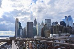 Dramatic City scene in NEw York. On the brooklyn bridge royalty free stock photo
