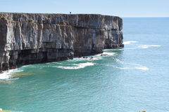 Dramatic cliffs and a sunny blue sea Royalty Free Stock Photos