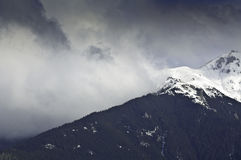 Dramatic cloud landscape in the mountains. In winter Stock Photos