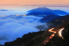 Dramatic cloud with mountain and car traffic light Royalty Free Stock Images