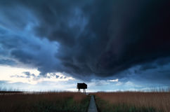 Dramatic cloud over coast with woodn tower Stock Images